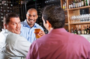Three men at bar after work