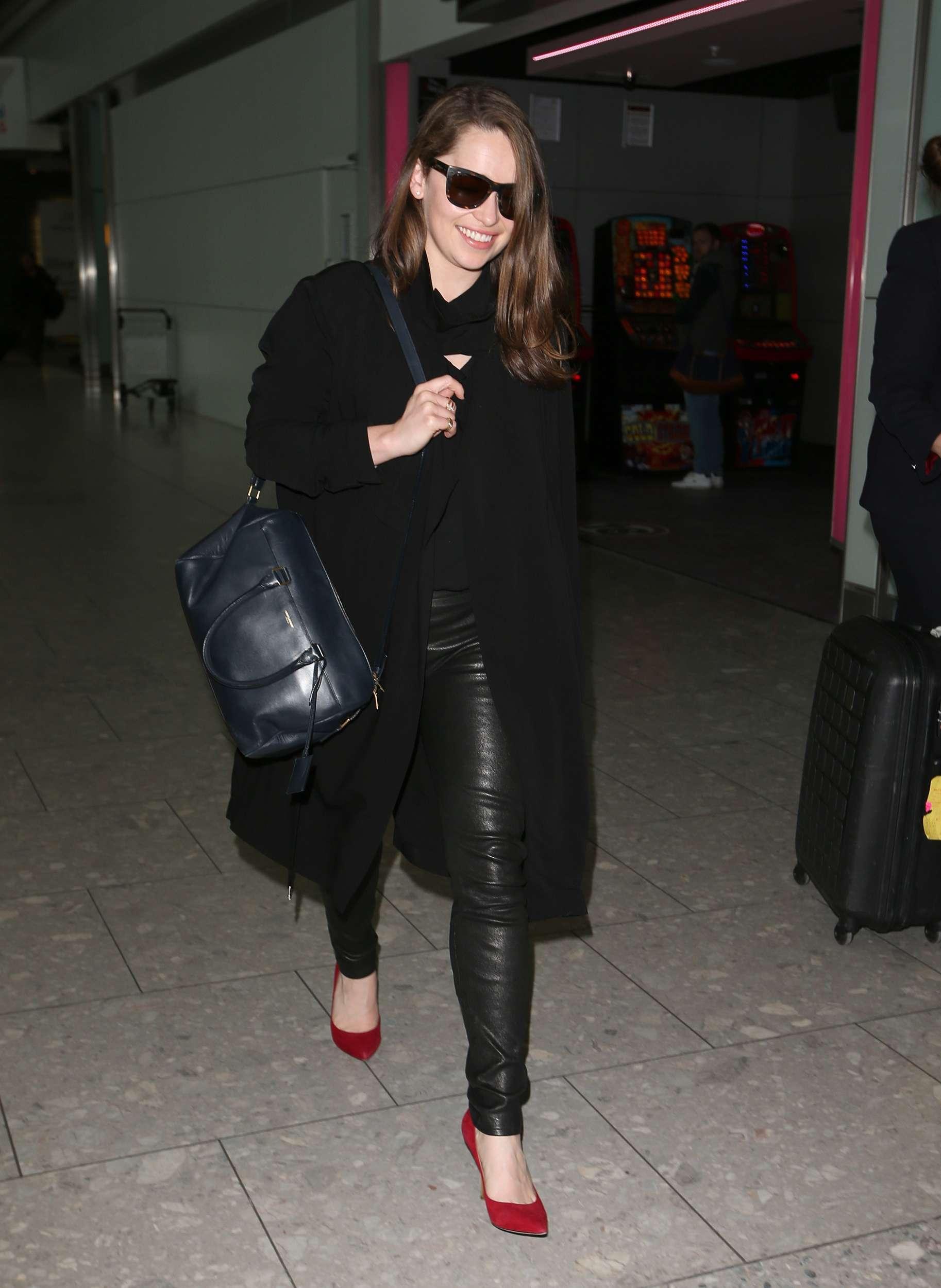 Emilia Clarke Walks Through Heathrow Airport Leather