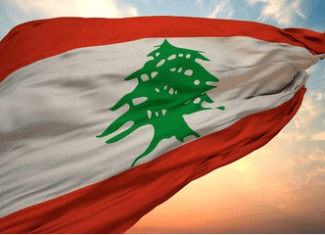 The flag of the Republic of Lebanon, Eden on Earth. The ancient cedar back-lit by a Mediterranean Sunset. Lebanon Law Review