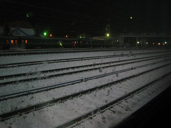 I'm awake in the middle of the night on a train in the middle of nowhere. But at least there's snow!