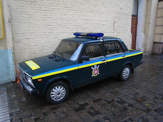 I realized I hadn't taken any photos of police yet in Moscow. Some drive cars like this with a little different color scheme. The car is a Lada, Russian made.