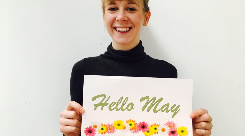 Girl holding a sign about May