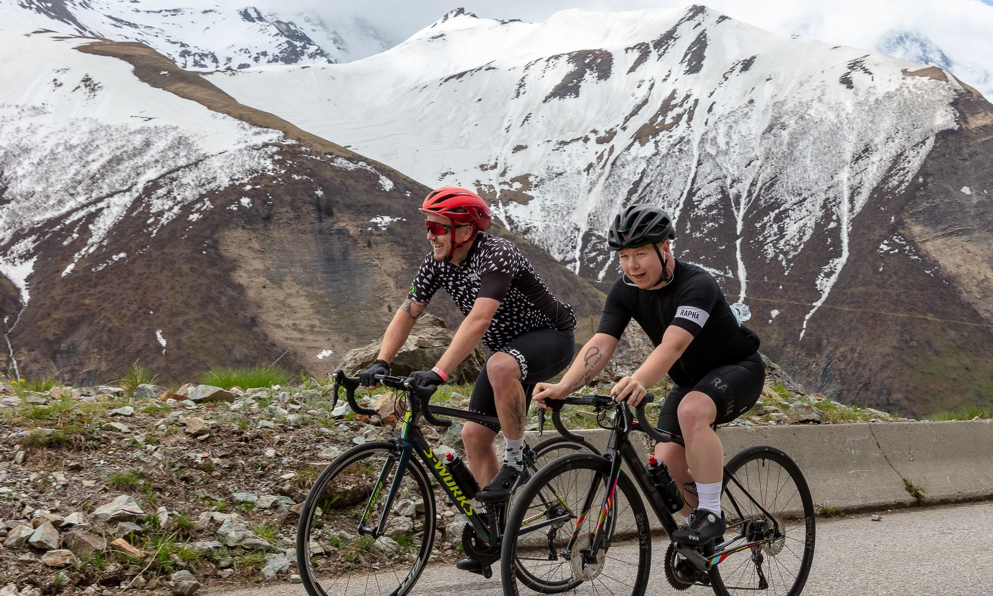 Two cyclists climbing the Croix de Fer