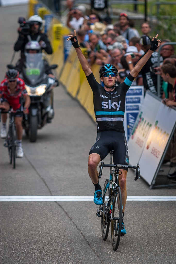 Chris Froome crosses the winning line in Vaujany