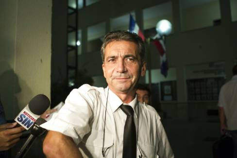"French pilot Bruno Odos, accused of trying to fly dozens of suitcases packed with cocaine from the Dominican Republic to France, convicted of crimes related to drug trafficking and sentenced to 20 years in prison, speaks on August 14, 2015. Odos and other three French citizens and 37 Dominicans are Involved in a drug trafficking case which the French media dubbed the ""Air Cocaine"" affair. AFP PHOTO / ERIKA SANTELICES - ERIKA SANTELICES/AFP"