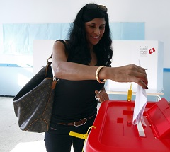 A Tunisian woman casts her vote at a polling station in Tunis