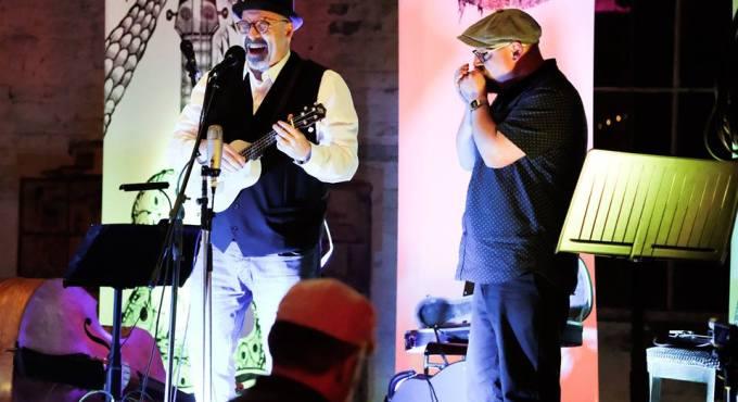 Sleepy Kev Bishop and Phil Doleman playing on stage.