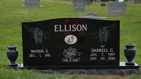 Grave marker with photo, etching and vases