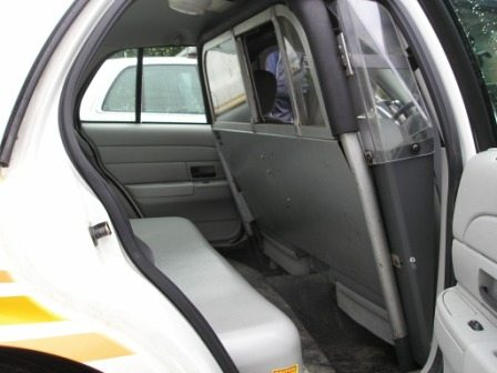 A Protective Screen Separates The Officer From Prisoner In Back Seat This Is Made Lightweight Aluminum And Plexiglas
