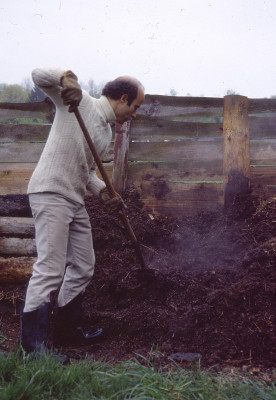 Turning compost pile.