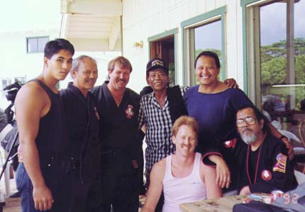 This photo was taken June 20, 1992 on Kauai during a large gathering of Kajukenbo students from around the world for a training session and get-together. Front row (sitting), left to right: George Hale (Leeward Kenpo), Sijo Adriano Emperado. Second row, (unknown Al Dela Cruz black belt), Ed Louis, Leeward Kenpo, George Iversen, Iversen's Kajukenbo, Sid Asuncion, Al Dela Cruz, Dela Cruz Kajukenbo.