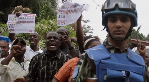 Des jeunes manifestent pour contester les résultats de l'élection présidentielle, ce vendredi. (Crédits photo: Dieu Nalio Chery/AP)