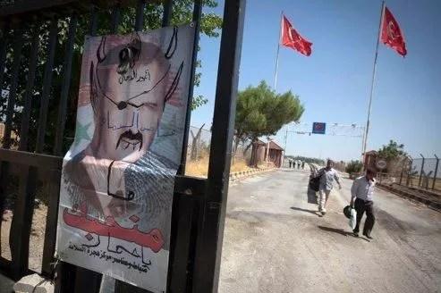 Un portrait de Bachar el-Assad tagué.