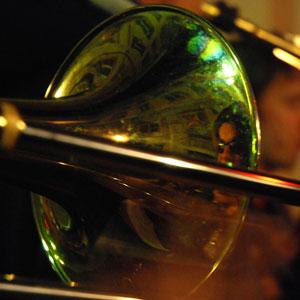 Reflection of trombone player in trombone