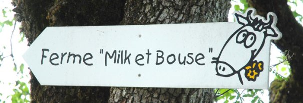 <Picture of the signpost for the Milk et Bouse farm in St Jean de Sixt, France.>