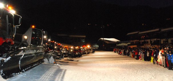 <Photo of a row of piste bashers/groomers/mogul munchers facing a crowd in La Clusaz, France>