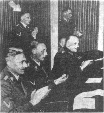 Three SS men: from the left: Karl Frank, Rudolf Heydrich (sitting) and Theodore Oberländer (standing)