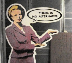 """cardboard cut-out of Margaret Thatcher with speech bubble saying """"there is no alternative"""""""
