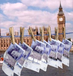 £20 notes hanging on a line with the Houses of Parliament in the background