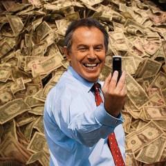Blair selfie in front of pile of cash