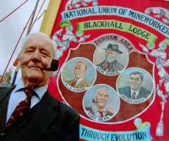 Tony Benn and a miners banner