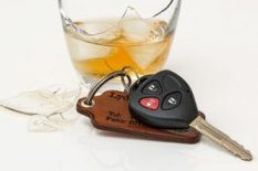 car key and glass of alcohol