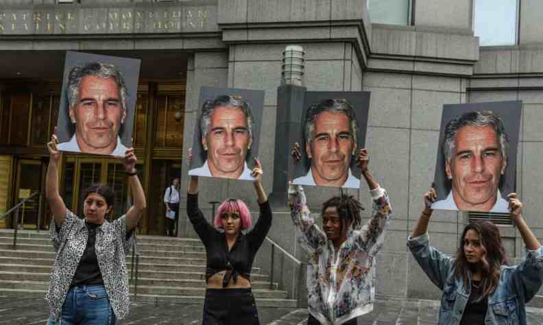 A protest group hold up signs of Jeffrey Epstein in front of the federal courthouse on 8 July 2019 in New York City. Photograph: Stephanie Keith/Getty Images
