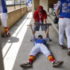 """""""...98, 99, 100!"""" Zach Schirner of Midland Mich., Post 165, needs help with his """"presses"""" from Brady Tucker, the grandson of Midland's manager before the start of their game against Henderson, Nev., Post 40 during game 10 of The American Legion World Series on Sunday, August 13, 2017 in Shelby, N.C.. Photo by Matt Roth/The American Legion."""