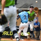 Sam Margulis of Hopewell, N.J., Post 339 beats Aaron Orender of Bryant, Ark., Post 298 to first base during game 7 of The American Legion World Series on Saturday, August 12, 2017 in Shelby, N.C.. Photo by Lucas Carter/The American Legion.