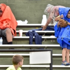 Fans put on their rain gear during game 13 of The American Legion World Series on Monday, August 14, 2017 in Shelby, N.C.. Henderson, Nev., Post 40 defeated Bryant, Ark., Post 298 7-3 in nine-innings. Photo by Matt Roth/The American Legion.