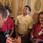 Keven Hernandez Nuno, center reacts with excitement after Joni Ernst (R-IA) in the Senate Reception Room in the US Capitol Building signed a book for him. American Legion Boys Nation and American Legion Auxiliary Girls Nation take to Capitol Hill to meet with their senators and legislative staff on Thursday, July 27, 2017. Photo by Lucas Carter / The American Legion.