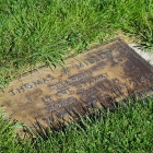 Before the cleanup - the grass around the grave marker was overgrown, and the marker itself was tarnished and weathered. Photo by Holly K. Soria/The American Legion