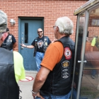 Dennis McDonough, the Road Captain of J Group, leads a meeting during Legacy Run orientation on Friday, August 11, 2017. Photo by Clay Lomneth / The American Legion.