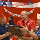 American Legion National Commander Charles E. Schmidt and Kansas Department Commander Terry Marr present Kansas Soldiers' Home Superintendent David Smith with a plaque and OCW donation on Friday, August 11, 2017. Photo by Clay Lomneth / The American Legion.