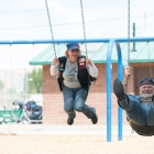 Linda Clark and Jim Williams take a break on the swings in Green River, Utah on Monday, August 14, 2017. Photo by Clay Lomneth / The American Legion.