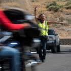 Rhonda Cowen of the advance team directs bikes into Ely, Nev. on Tuesday, August 15, 2017. Photo by Clay Lomneth / The American Legion.