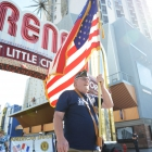 Past National Vice Commander Doug Haggan carries an American flag in the American Legion parade through downtown Reno, Nev. on Sunday, August 20, 2017. Photo by Clay Lomneth / The American Legion.