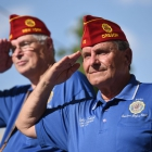 American Legion National Commander Charles Schmidt salutes as the parade passes the viewing booth in downtown Reno, Nev. on Sunday, August 20, 2017. Photo by Clay Lomneth / The American Legion.