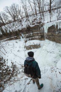 james-in-front-of-frozen-tew-falls-in-ontario-2018