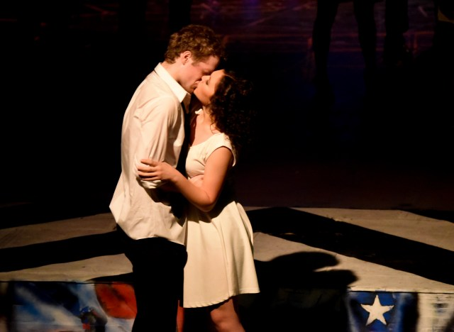 """Lead actors Andrew James Tesch """"Benny"""" and Maddie Beck """"Nina"""" share an on-stage kiss."""