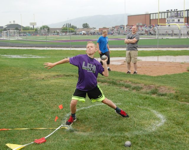 11-year-old Kyler Young throws the shotput. In his first year, Kyler advanced from a starting 17-feet throw to a 25-feet personal best. Photo: Cavett Ishihara