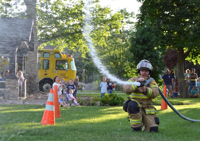 Spanish Fork firefighter competes in the muster. Photo: Nicole Kunze