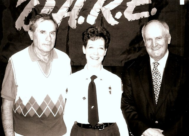 Boyd and Kathy Stewart with LaVell Edwards for a D.A.R.E. event.