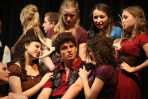 """Gaston surrounded by admirers in Skyridge's """"Beauty and the Beast."""""""