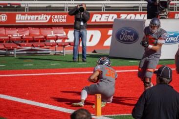 Skyridge football player #32 Ma'o Natoa dives for a touchdown. I Riley Livingston