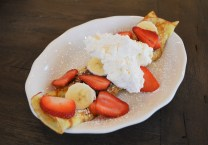 A Nutella Crepe with strawberries, bananas, and whipped cream. | Nicole Kunze