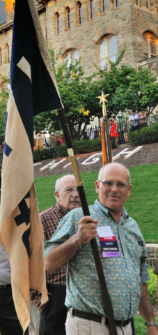 Howard Foltz '77 '80G carries the flag of his father's class during Lehigh's First-Year Student/Alumni Rally--an annual tradition that celebrates Lehigh history and welcomes first year students.