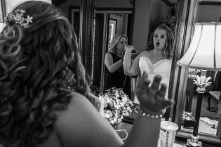 Bride getting her dress tightened, Pilot Mountain, NC