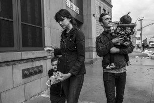 Family walking on Brooklyn sidewalk, Brooklyn, NY