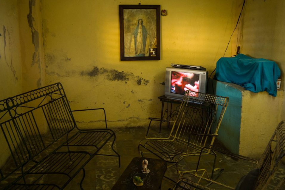 The interior of a house in Santiago de Cuba. In the empty room on the television there are only documentaries about Fidel Castro. Santiago de Cuba, 4 December 2016. I was in Santiago for the official funeral ceremony, when I saw this scene in a nearby house and I took this photo.